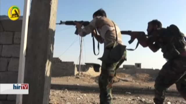 Síita fegyveresek harcolnak az Iszlám Állam fegyvereseivel