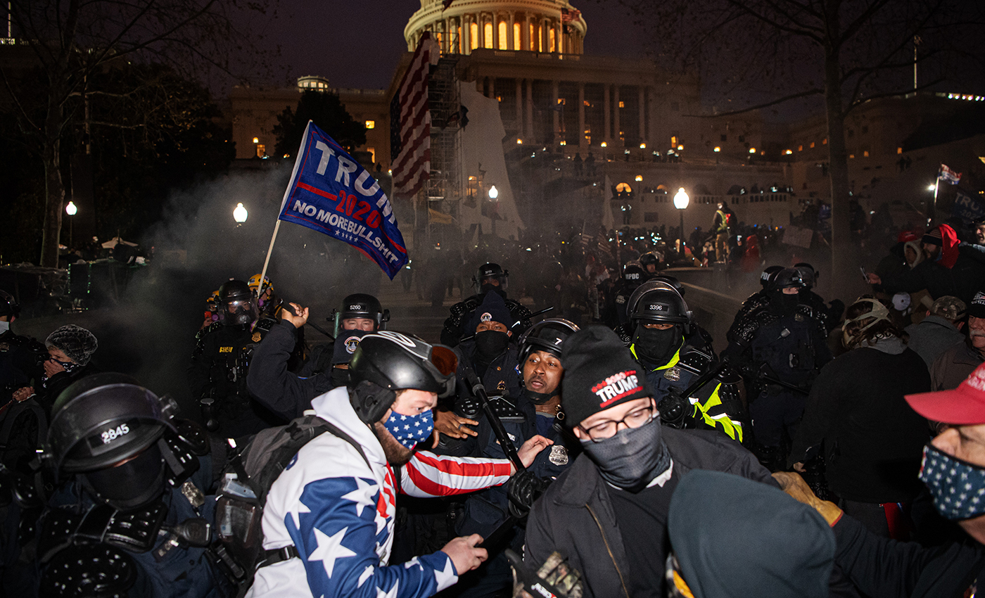 A Trump aide was charged with assault at the Capitol riot.