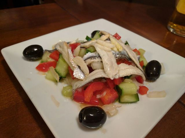 Anchovies in vinegar on a bed of crispy salad