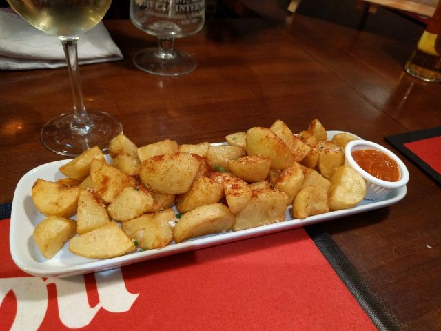 Twice cooked potatoes served with paprika & salsa brava.