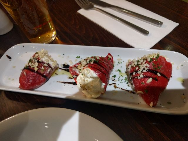Sweet peppers, filled with cream cheese, topped with nuts.