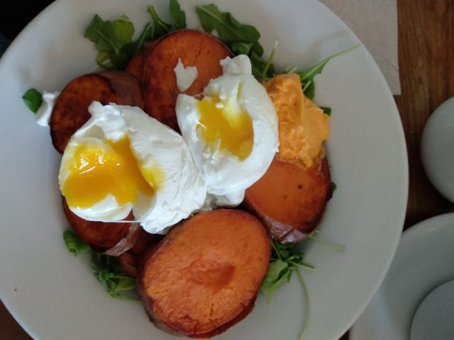 Yams and eggs with arugula and spicy Sriracha butter
