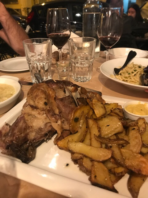 Roasted lamb with thyme accompanied by potatoes and gamopilafo