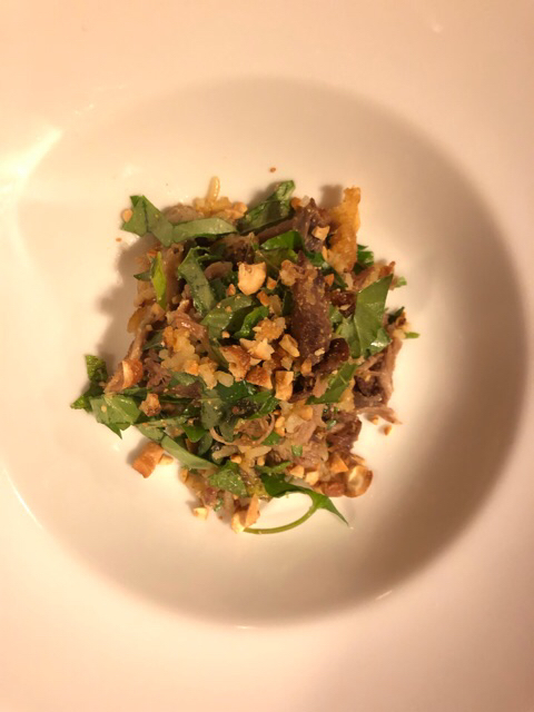 Crispy duck confit fried rice salad, cashew nuts and herbs.