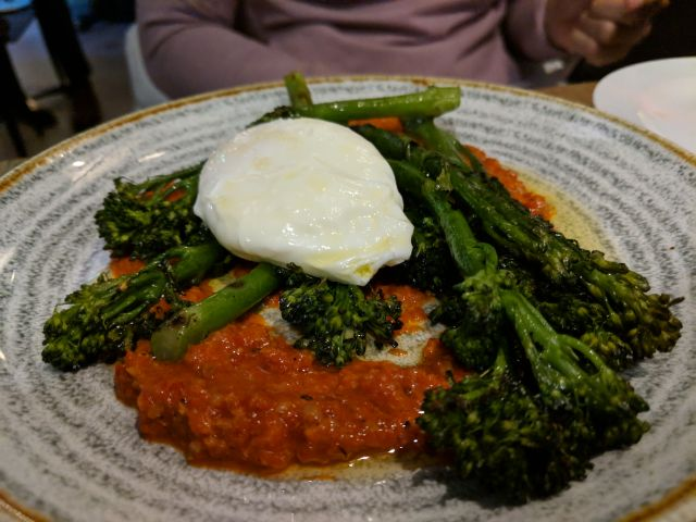 Grilled tenderstem broccoli, poached egg and romesco sauce