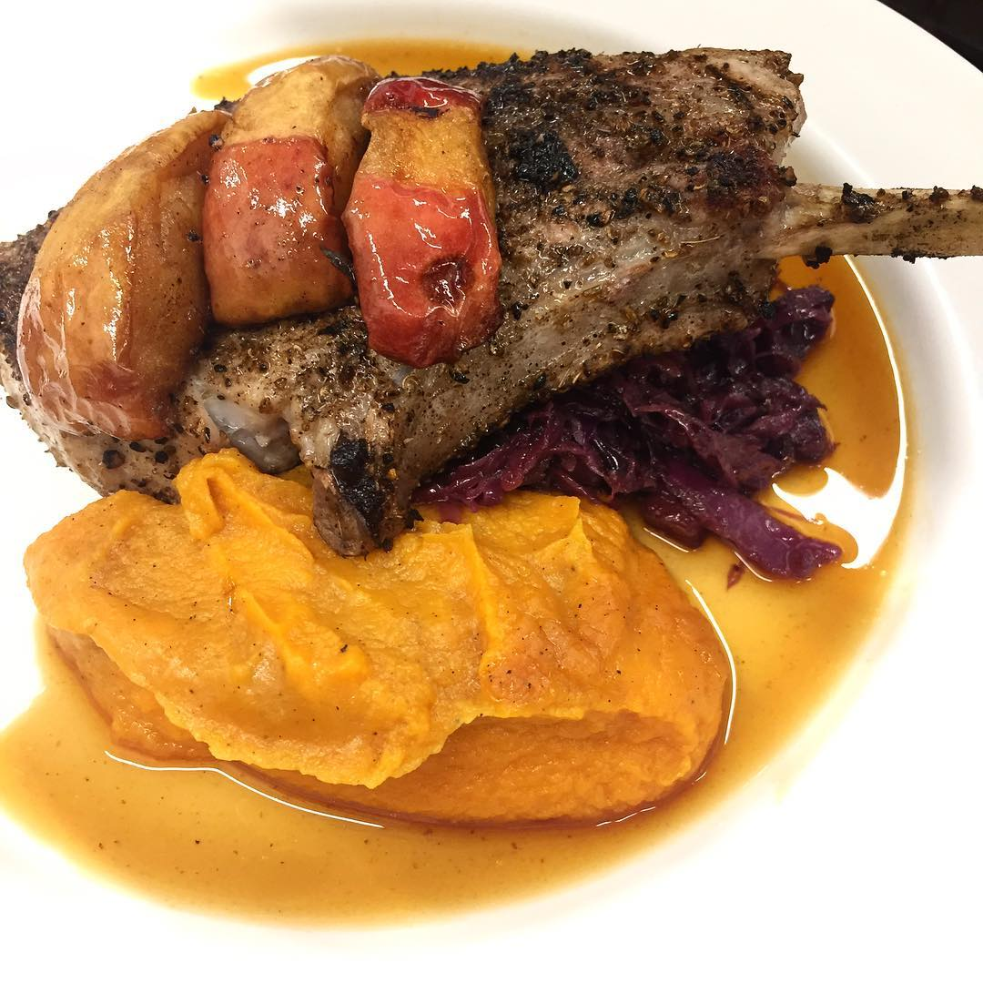 Grilled pork chop with bacon braised red cabbage, vanilla scented sweet potato puree and caramelized apples