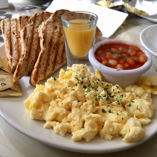 Scrambled eggs on brown bread toast